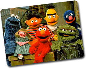 seven puppets AKA Muppets, posed for a picture